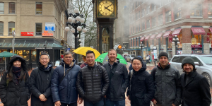 Maple members, alumni and Launch team in front of the famous Gastown Steam Clock.